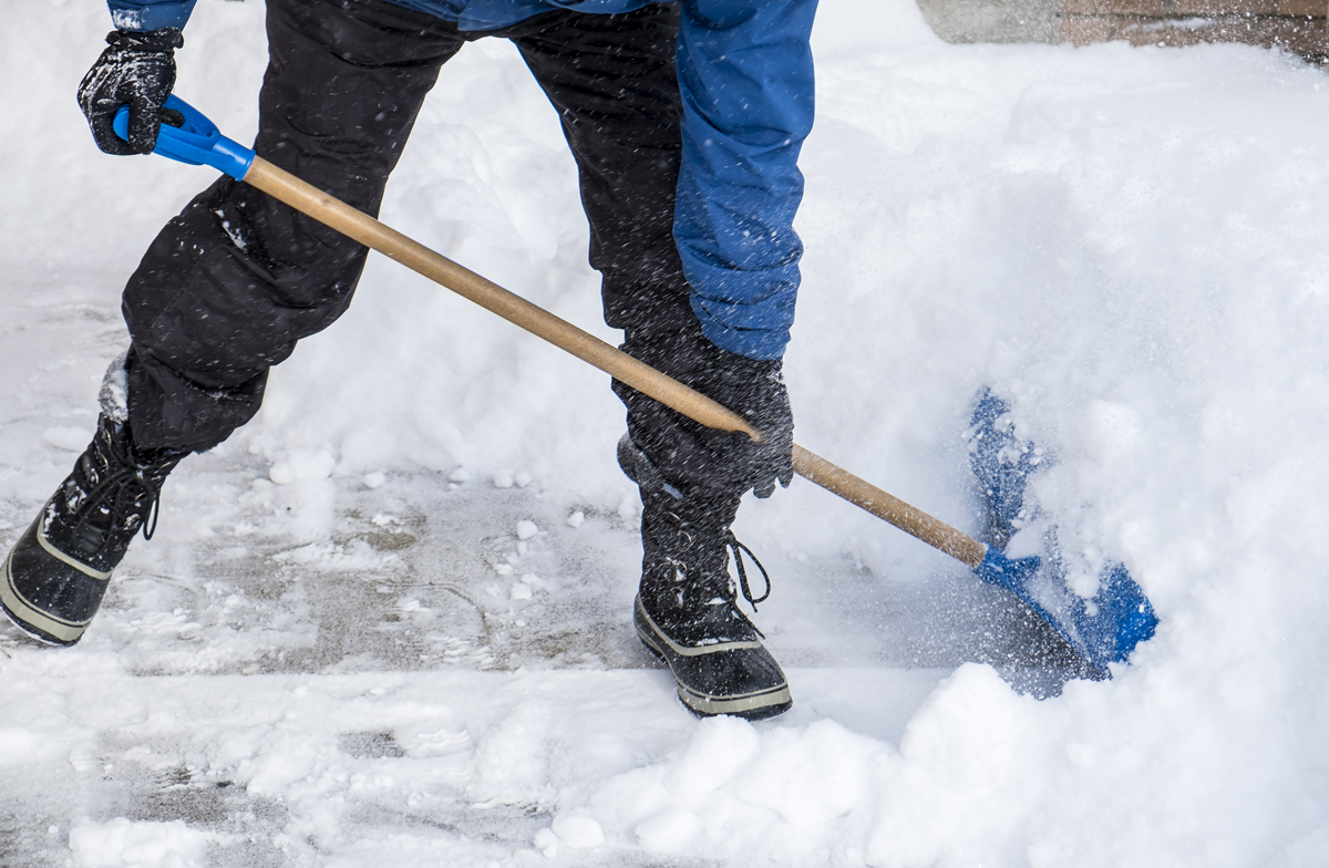 bigstock-Man-Removing-Snow-with-a-Shove-81683726
